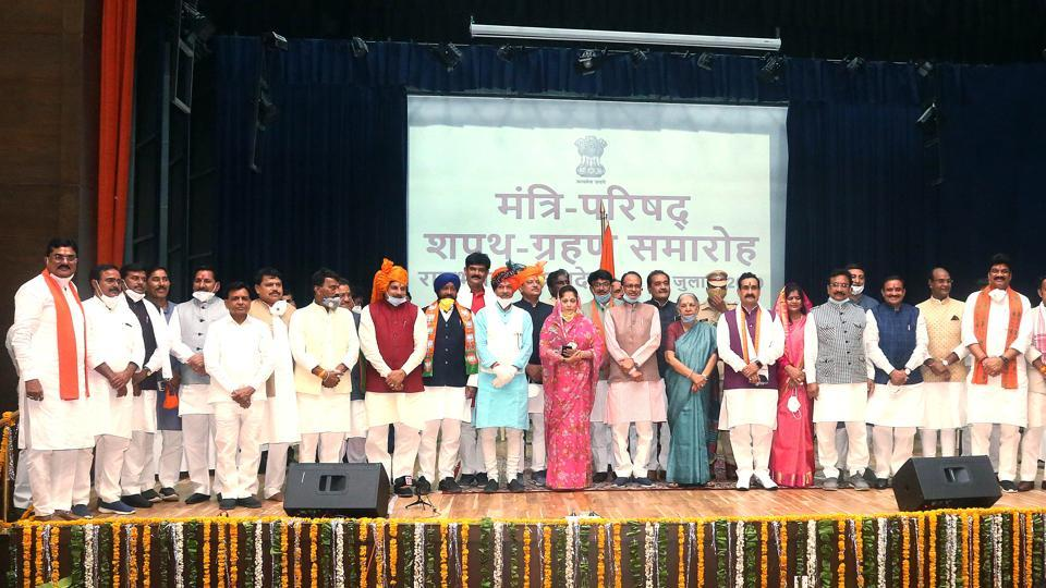 Madhya Pradesh Governor Anandiben Patel and Chief Minister Shivraj Singh Chouhan with newly inducted Cabinet Ministers during oath ceremony at Raj Bhawan in Bhopal, July 2, 2020.