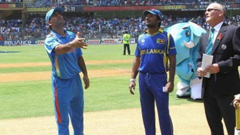MS Dhoni of India tosses the coin for the second time with Kumar Sangakkara of Sri Lanka looking on during the 2011 ICC World Cup Final between India and Sri Lanka at Wankhede Stadium on April 2, 2011 in Mumbai, India. (Photo by Hamish Blair/Getty Images)