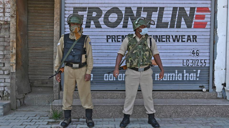 Indian paramilitary troopers stand guard in central Srinagar on June 10, 2020.