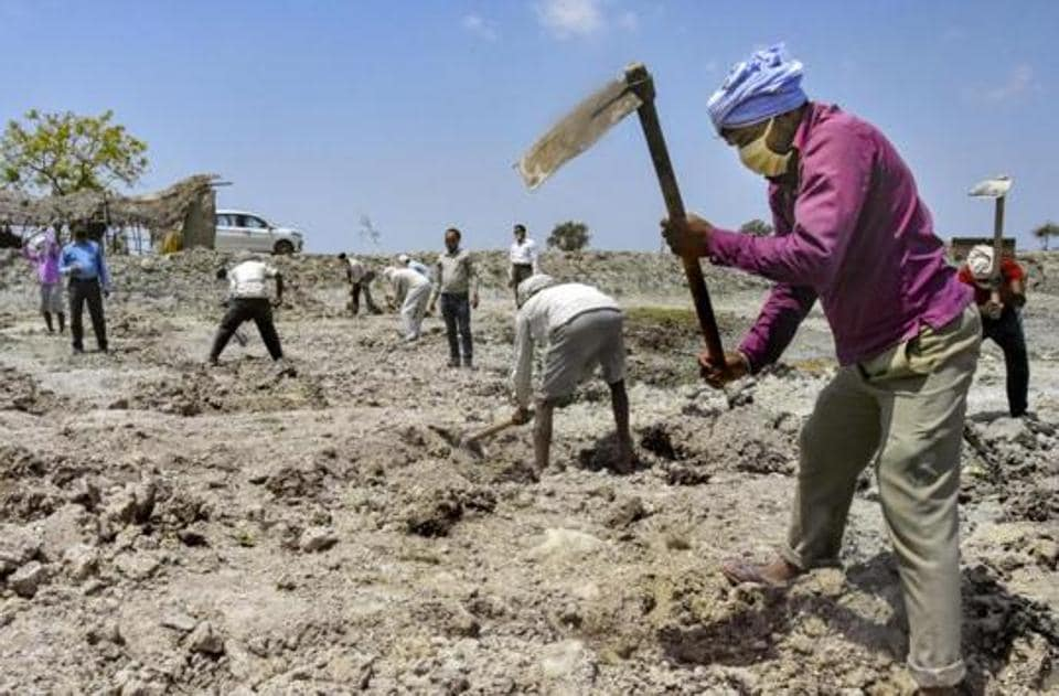 Labourers working at a MNREGA site in a village in Amethi district of Uttar Pradesh.