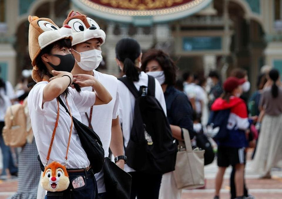 Visitors wearing Disney character hats wait for the reopening of Tokyo Disneyland along with Tokyo DisneySea, which closed for months due to the coronavirus disease (COVID-19) outbreak, at the entrance gate of Tokyo Disneyland in Urayasu, east of Tokyo, Japan July 1, 2020.  (REUTERS)