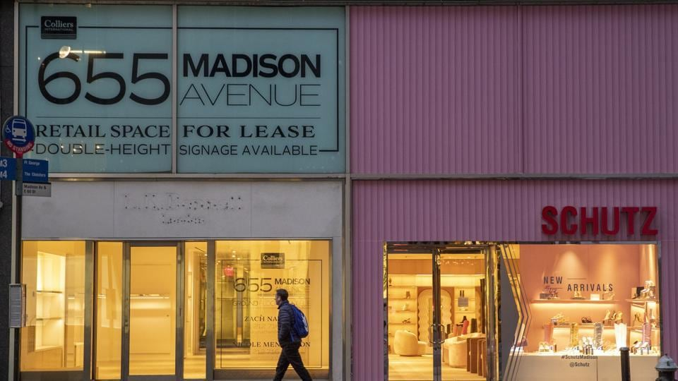 File photo of  a pedestrian walking past a storefront for rent on Madison Avenue, in New York. The coronavirus has had an impact on the commercial real estate markets.
