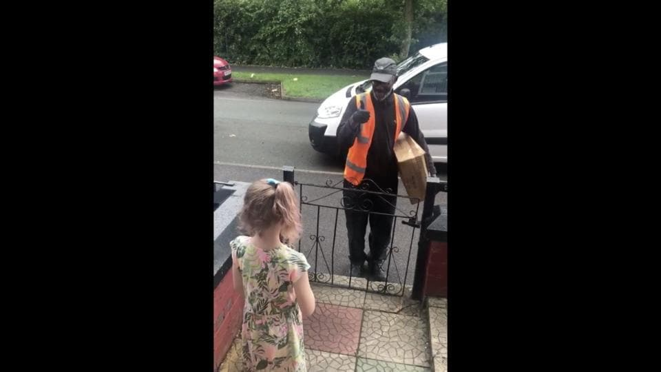 The image shows eight-year-old Tallulah and delivery man Tim.
