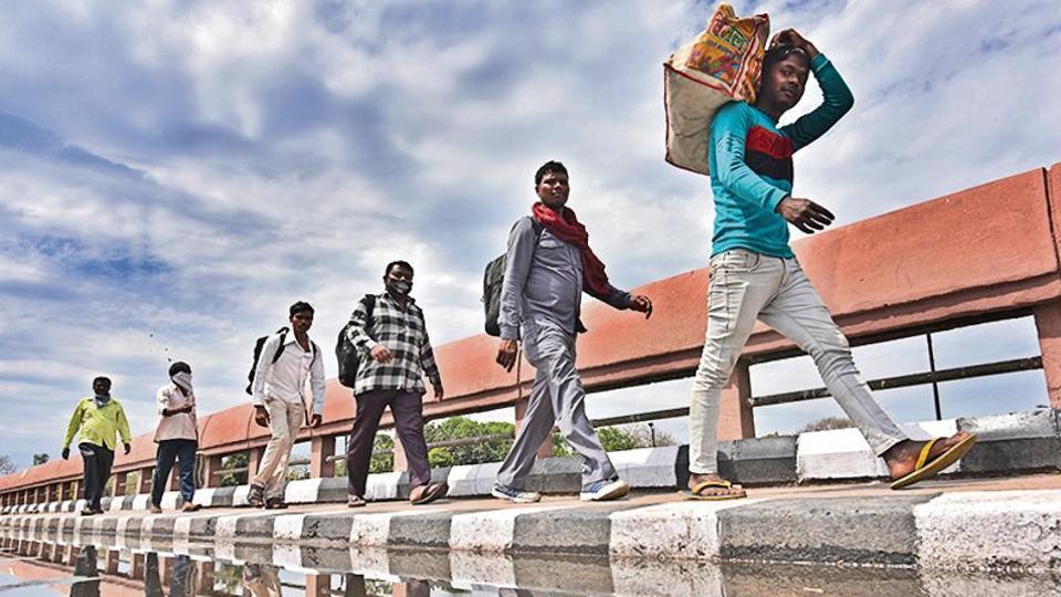 Migrant workers in Delhi walk back to their villages in Uttar Pradesh in March.