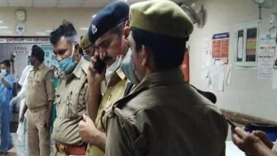 Police officers from the Uttar Pradesh police department speak to the injured policemen. Police officers in Kanpur were attacked by Vikas Dubey's gang when they were raided on Friday.