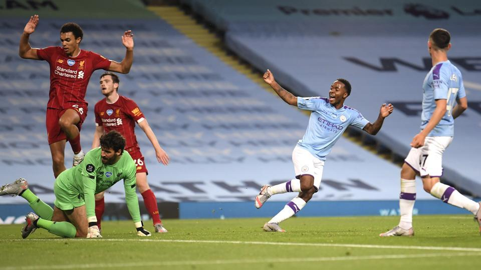 Manchester City's Raheem Sterling, second right, celebrates after his team's fourth goal during the English Premier League soccer match between Manchester City and Liverpool at Etihad Stadium in Manchester, England, Thursday, July 2, 2020.