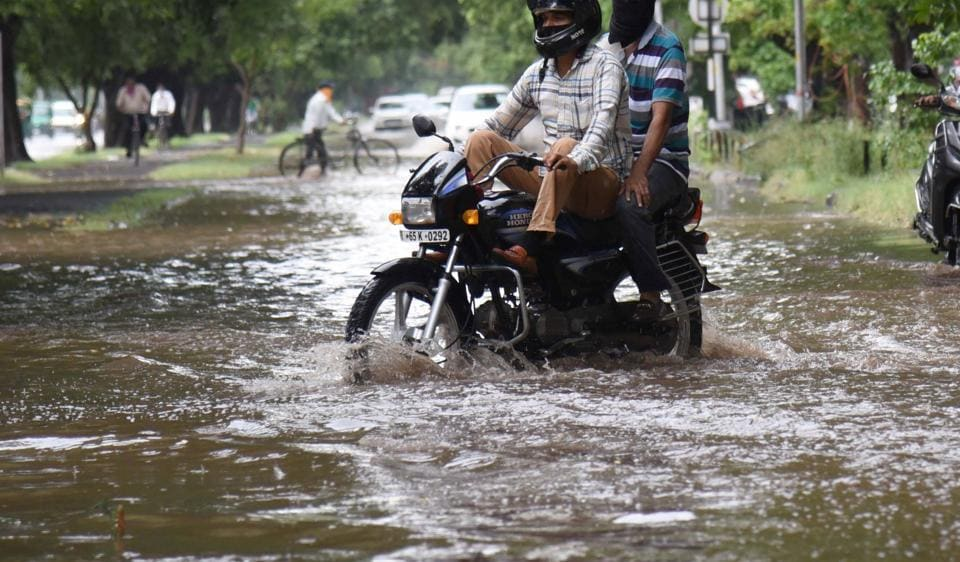Two wheeler riders struggle to get through a waterlogged spot in Sector 9 after a heavy spell of rain in June this year.