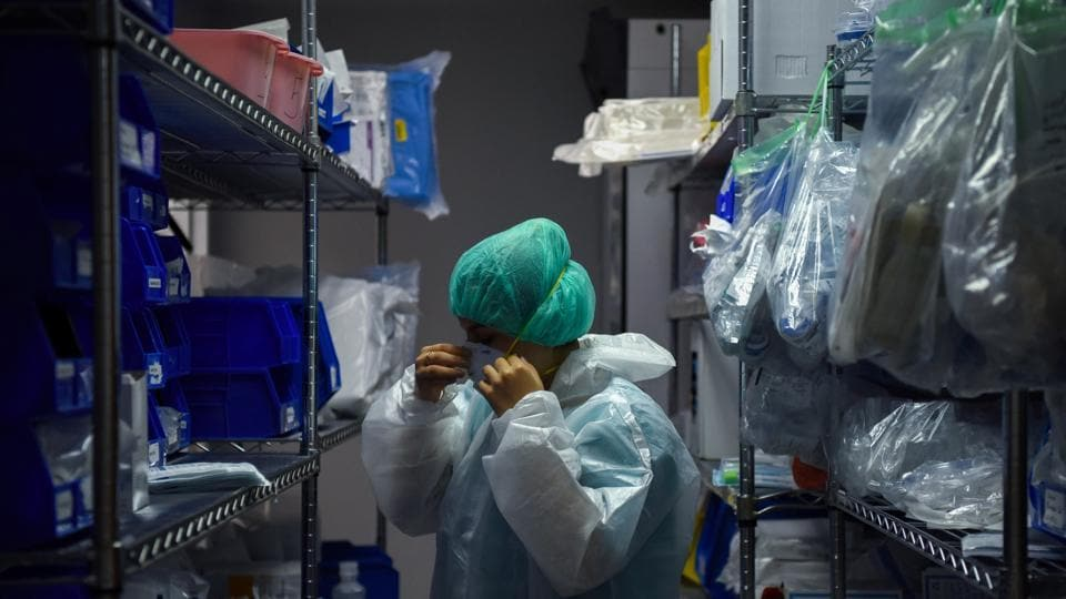 A medical worker puts on protective equipment as hospital staff treat coronavirus disease patients at the United Memorial Medical Center's coronavirus disease intensive care unit in Houston, Texas, US.