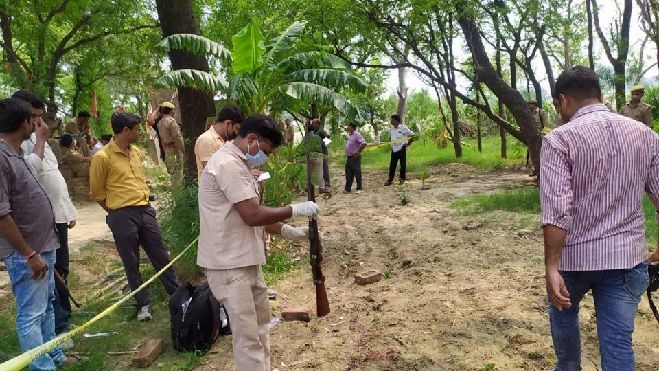 Police and forensic team members investigate the encounter site, where 8 police personnel lost their lives after being fired upon by criminals, in Kanpur.