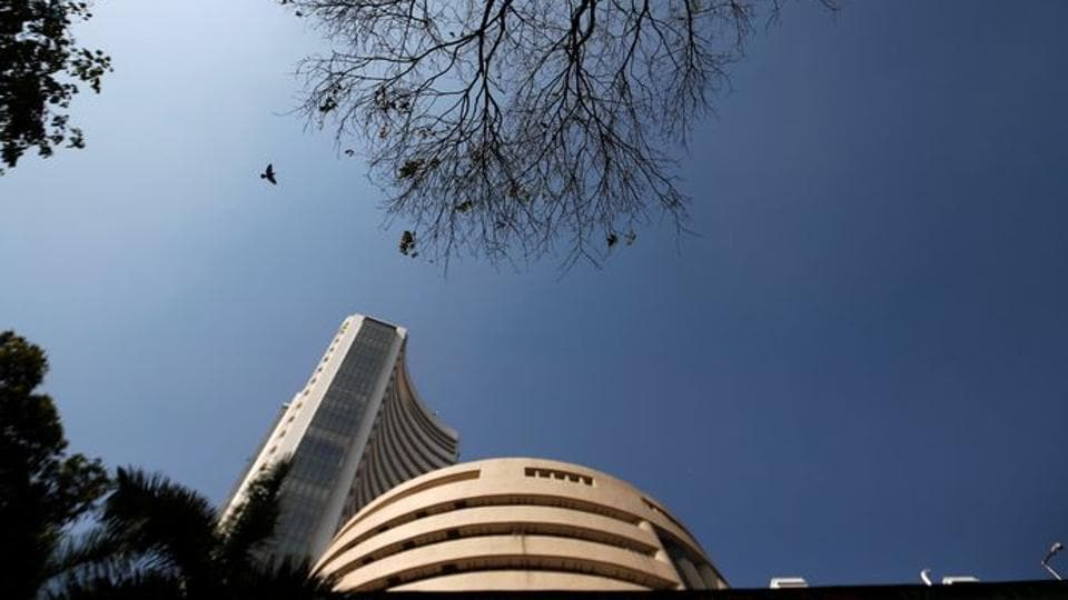 A bird flies past the Bombay Stock Exchange (BSE) building in Mumbai, India, January 31, 2020. REUTERS/Francis Mascarenhas/File Photo