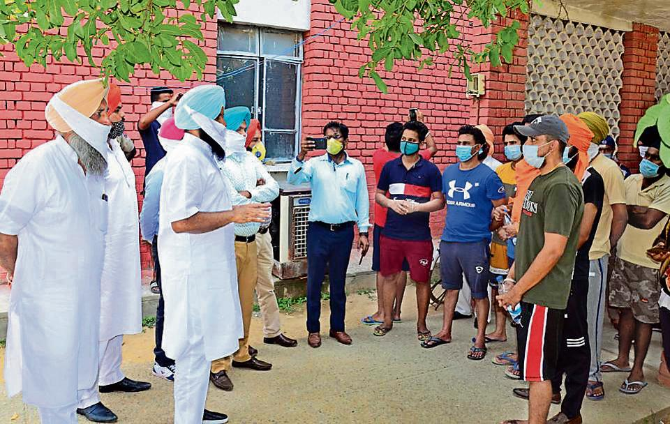 Lok Insaaf Party chief and MLA Simarjit Singh Bains interacting with residents brought back from Arab countries at Punjab Agricultural University quarantine centre in Ludhiana on Friday.