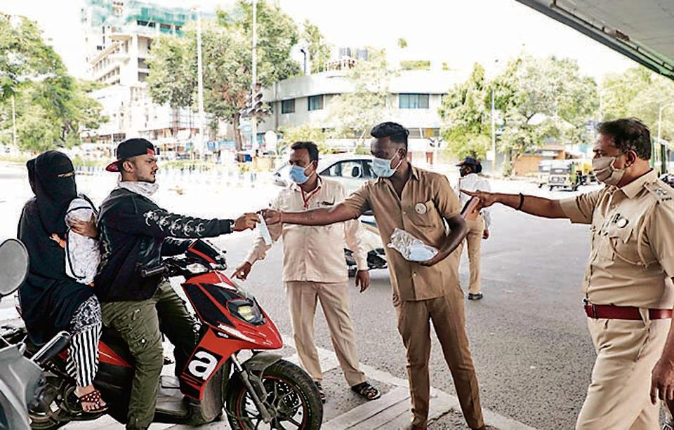 Pune police are seen enforcing the PMC directive for mandatory wearing of a mask at Seven loves chowk.