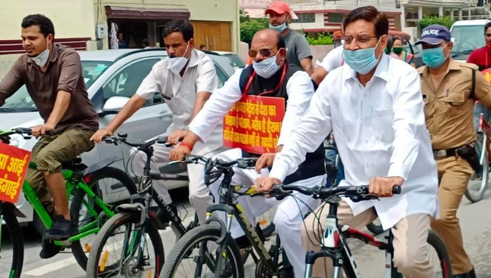 Congress president in Uttarakhand Pritam Singh (extreme right in white) during cycle rally against fuel price hike on Saturday in Dehradun.