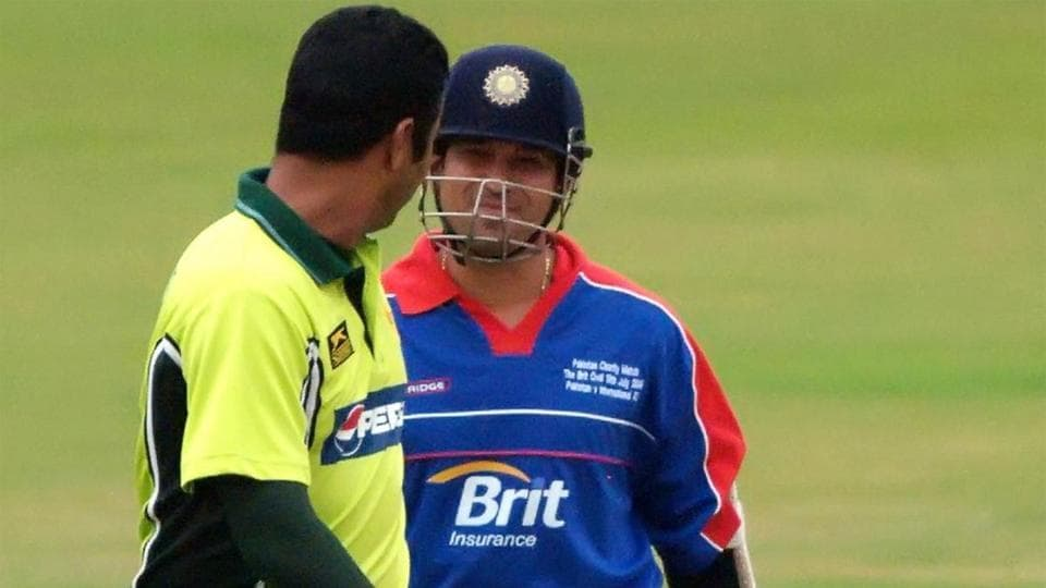 Sachin Tendulkar is greeted by Waqar Younis on his arrival at the crease during a Twenty20 match in 2006.