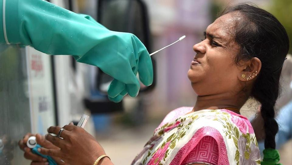 A woman gets her sample collected for COVID-19 swab testing at a medical camp in Chennai on June 29. Tamil Nadu on July 3 became the second state in India to cross one lakh cases, with a total of 102,721 people infected with Covid-19 disease, reported HT. (PTI)