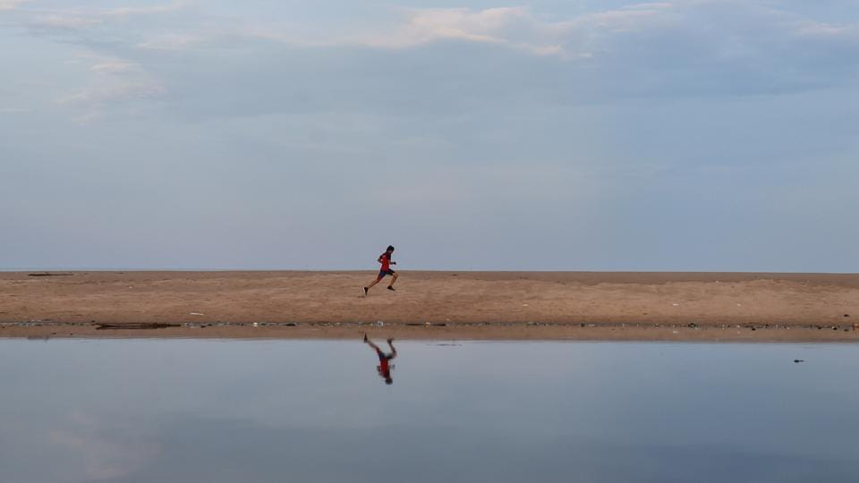 A man runs along the backwaters of Pattinapakkam beach in Chennai. Tamil Nadu said that the lockdown was warranted, as officials found that even symptomatic people were avoiding getting tested because they didn't want to be in quarantine. Besides this, some reports also suggested that people were also not following norms of social distancing or wearing masks while in public. (R Senthil Kumar / PTI)