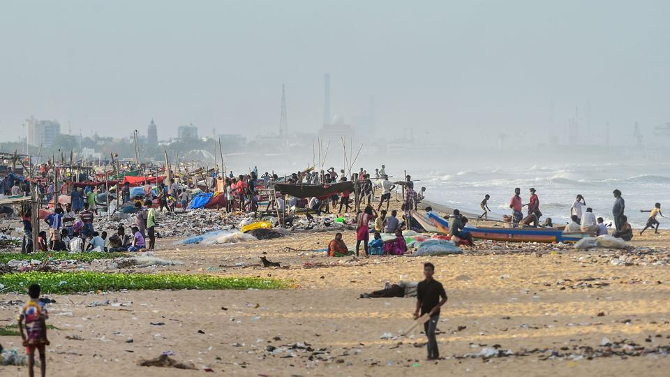 Fishermen seen near the Pattinapakkam beach during an intensified lockdown, in wake of the coronavirus pandemic in Chennai on July 2. Experts said the high numbers can also be attributed to the movement of people across the state post Unlock 1 which started on June 8. (R Senthiil Kumar / PTI)