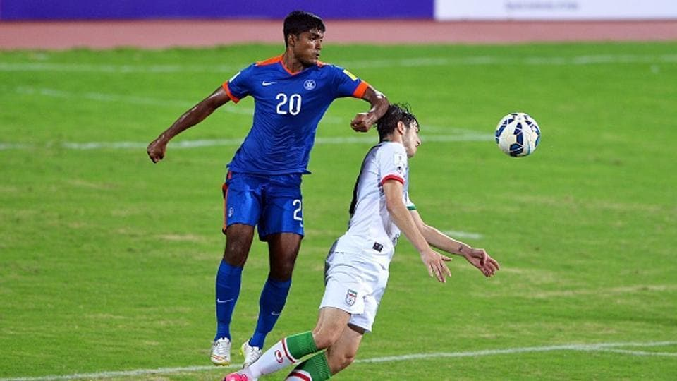 Indian player Pritam Kotal (L) and Iranian player Sardar Azmoun vie for the ball during the Group D FIFA World Cup 2018 qualifying football match between India and Iran.