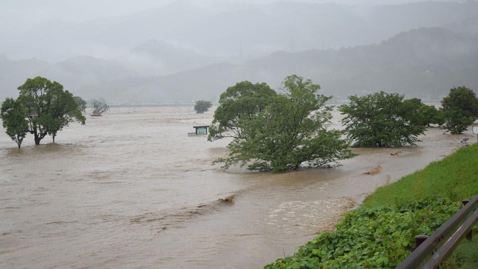 Rising water caused by heavy rain is seen at Kuma river in Yatsushiro, Kumamoto prefecture on July 4, 2020.
