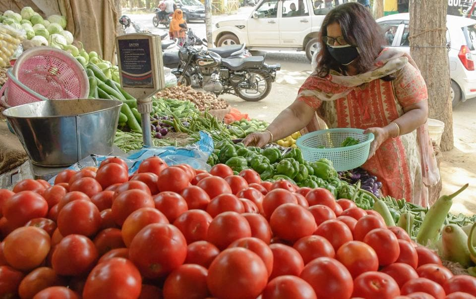 A customer buying vegetables from vendor in BRS Nagar, Ludhiana, on Saturday.