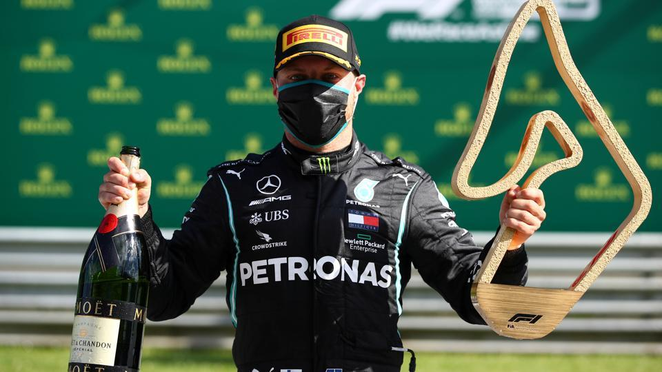 Mercedes' Valtteri Bottas celebrates with the trophy after winning the race.