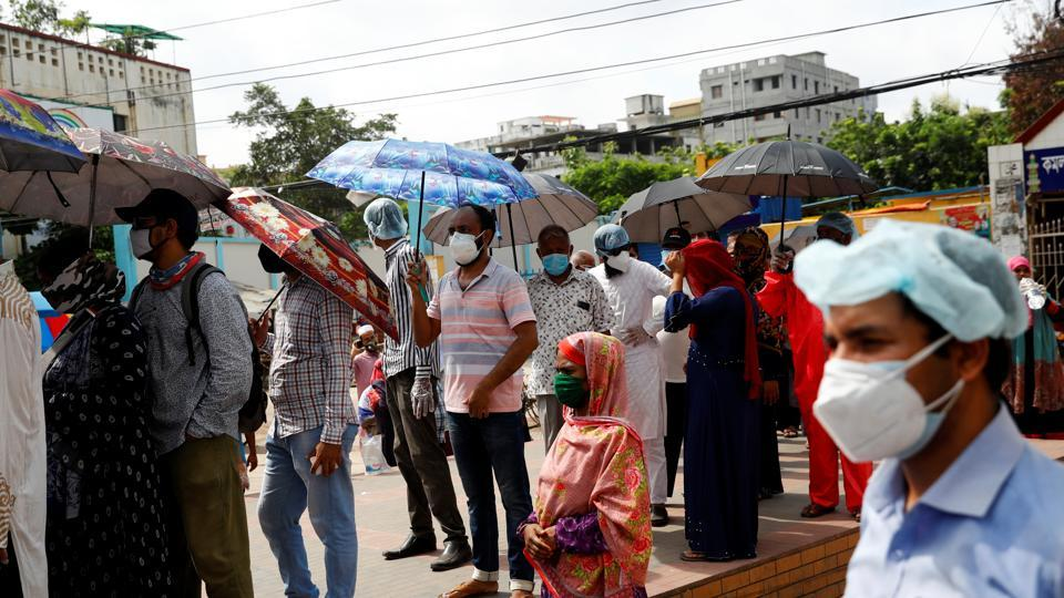 The piece of genome that the study found is responsible for the infection, is common in those living in Bangladesh. People are seen here waiting in the queue outside of a Covid-19 testing centre in Dhaka.