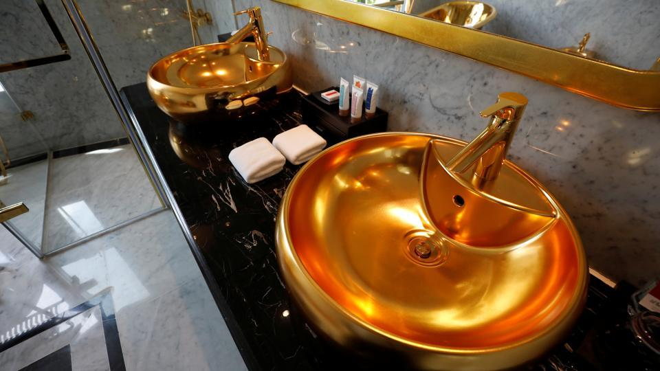 Gold plated bathroom sinks are seen in the newly-inaugurated Dolce Hanoi Golden Lake luxury hotel, after the government eased a nationwide lockdown following the global outbreak of the coronavirus disease (COVID-19), in Hanoi, Vietnam. (REUTERS/Kham)
