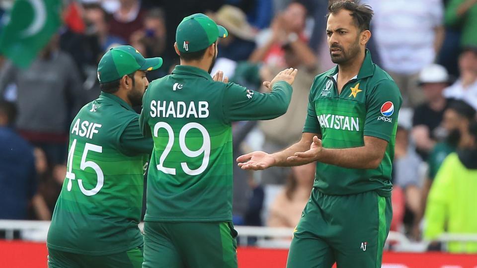 Pakistan's Wahab Riaz (R) celebrates with teammates
