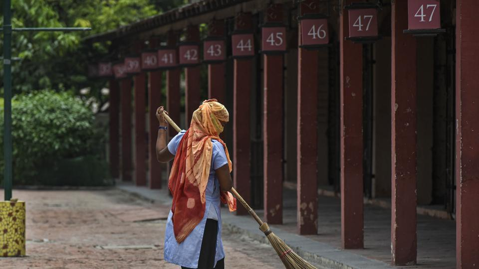 A worker cleans the premises at Dilli Haat ahead of its reopening in New Delhi, India, on July 4, 2020.