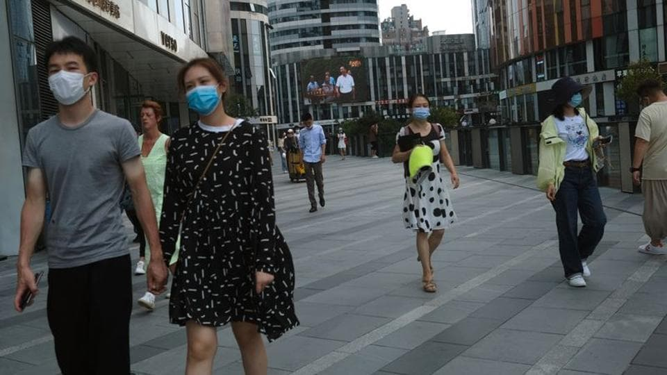 People wearing face masks are seen at the Sanlitun shopping area, following the outbreak of the coronavirus disease (COVID-19), in Beijing, China July 1, 2020.