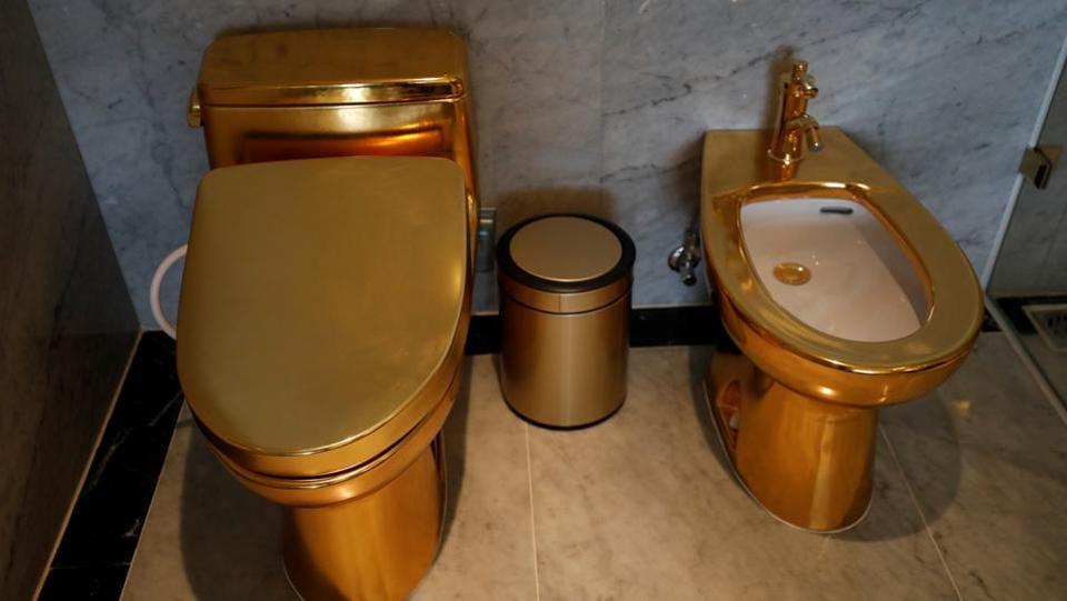 Gold plated toilets are seen at the newly-inaugurated Dolce Hanoi Golden Lake hotel, after the government eased a nationwide lockdown following the global outbreak of the coronavirus disease (COVID-19), in Hanoi, Vietnam. (REUTERS/Kham)