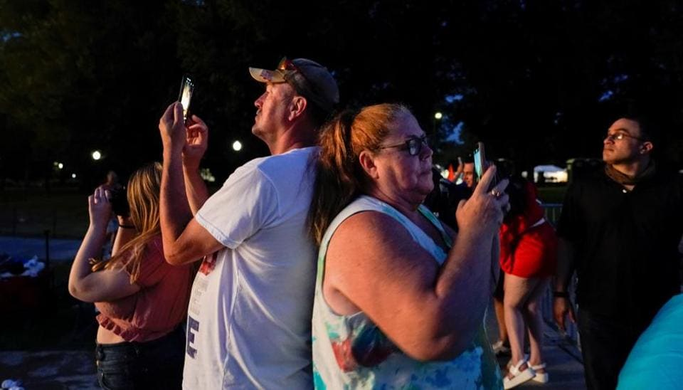 People use their phones during Independence Day celebrations in Washington, U.S., July 4, 2020. REUTERS/Joshua Roberts