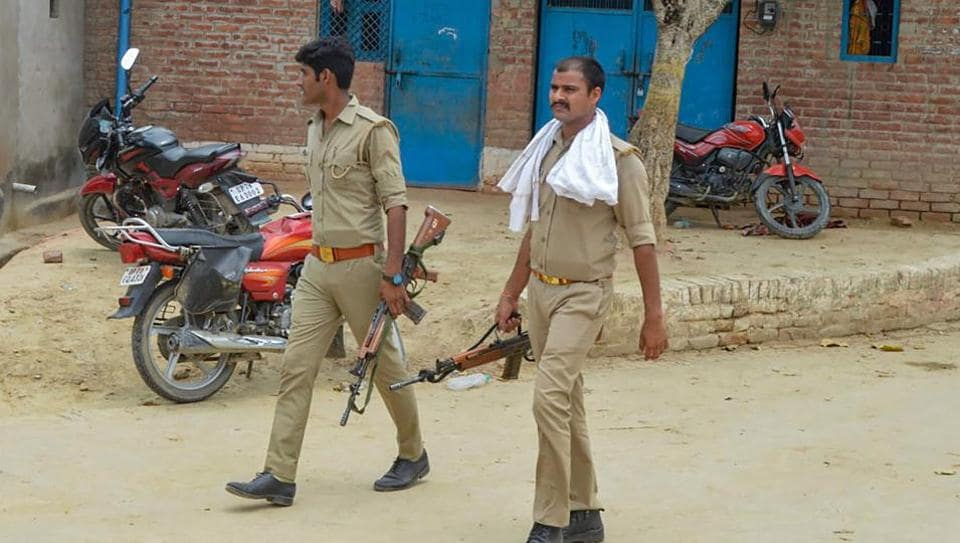 Police personnel during a search operation near the residence of main accused in the Kanpur encounter case, Vikas Dubey, in Kanpur on Sunday.