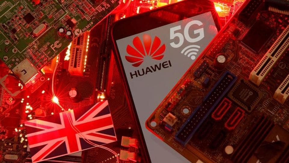 The British flag and a smartphone with a Huawei and 5G network logo are seen on a PC motherboard in this illustration picture.