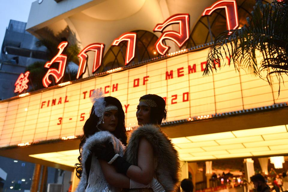 Movie fans pose as they gather to bid farewell to the last stand-alone movie theatre La Scala amid the spread of the coronavirus disease (Covid-19) in Bangkok, Thailand.  (REUTERS/Chalinee Thirasupa)