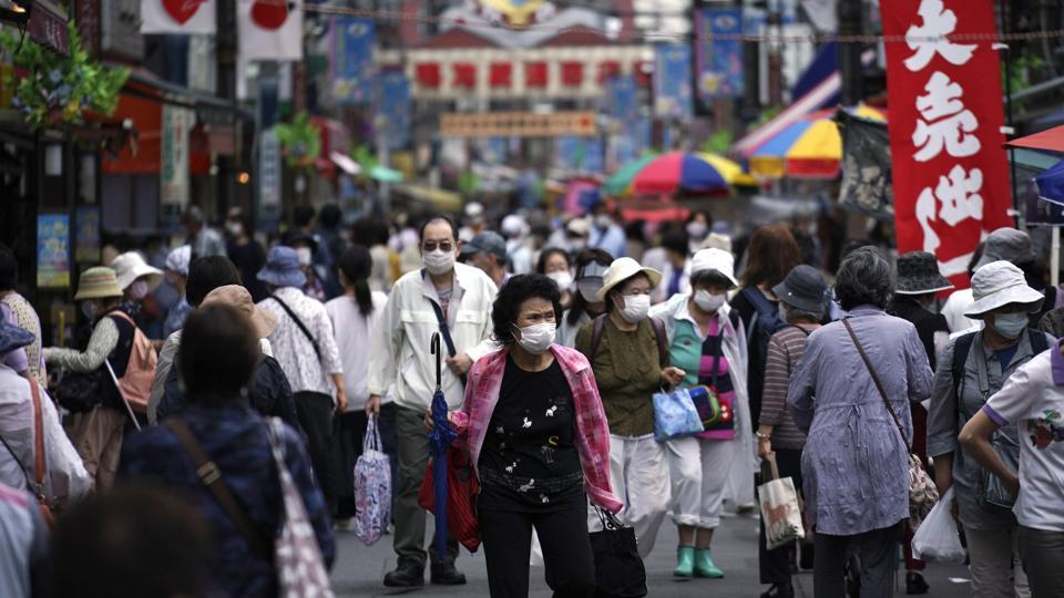 A street is crowded by shoppers in Tokyo. Japan's economy is opening cautiously, with social-distancing restrictions amid the coronavirus pandemic.