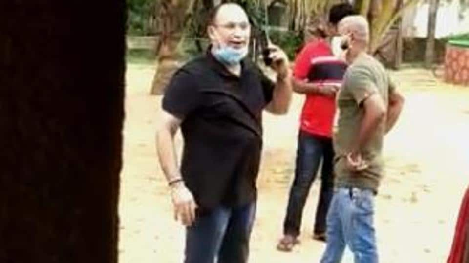 """Defending himself, MLA Glenn Souza Ticlo (in black T-shirt) said he only visited the location """"for a few minutes"""" because he was called there by a close aide. (Videograb)"""