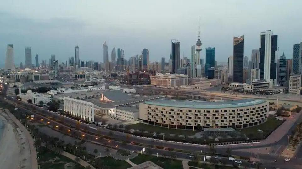 An aerial view shows Kuwait City and the National Assembly building.