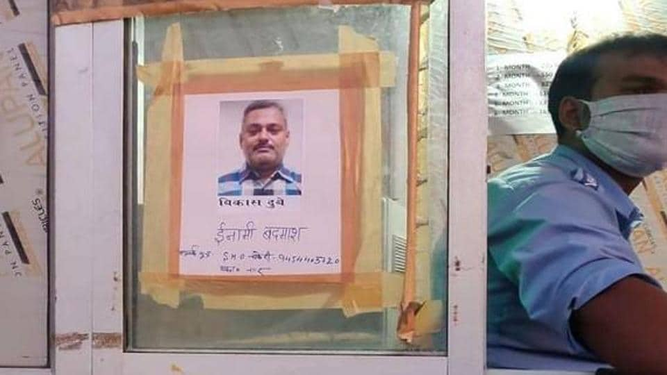 Vikas Dubey's photo was put up at Unnao toll plaza on Monday by the police.