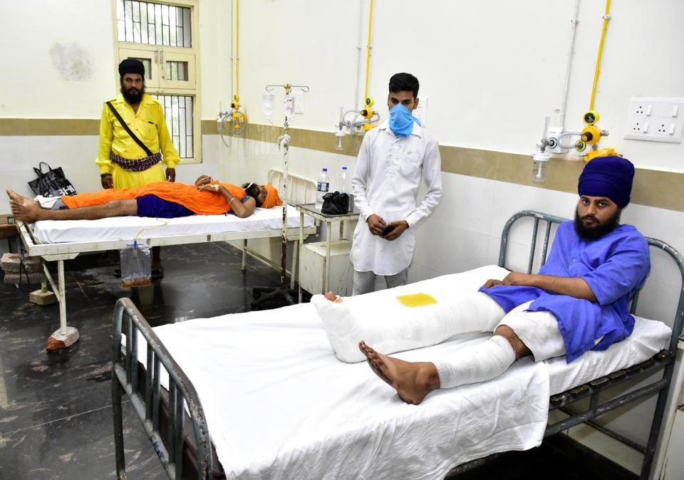 The injured Nihangs undergoing treatment at Guru Nanak Dev Hospital in Amritsar on Monday.