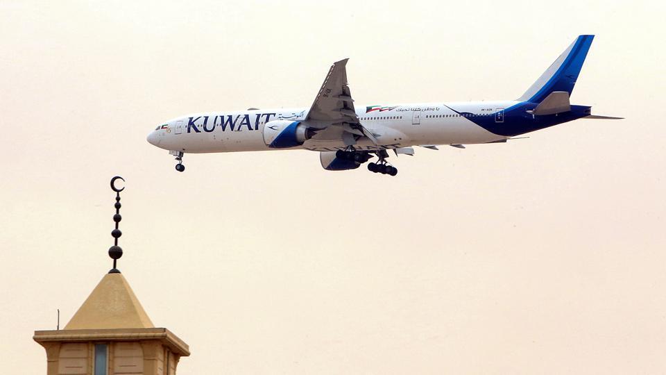 A Kuwait Airways Boeing B777 aircraft prepares to land at Kuwait International Airport in Kuwait City.