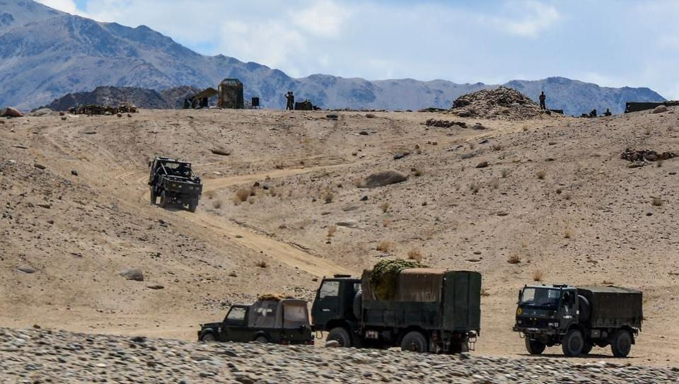 Indian army soldiers drive vehicles along mountainous roads as they take part in a military exercise in union territory of Ladakh on July 4, 2020.