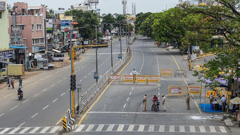 Poonamallee High Road wears a deserted look during an intensified lockdown as a preventive measure against the spread of coronavirus disease, in Chennai, Sunday, July 5, 2020.