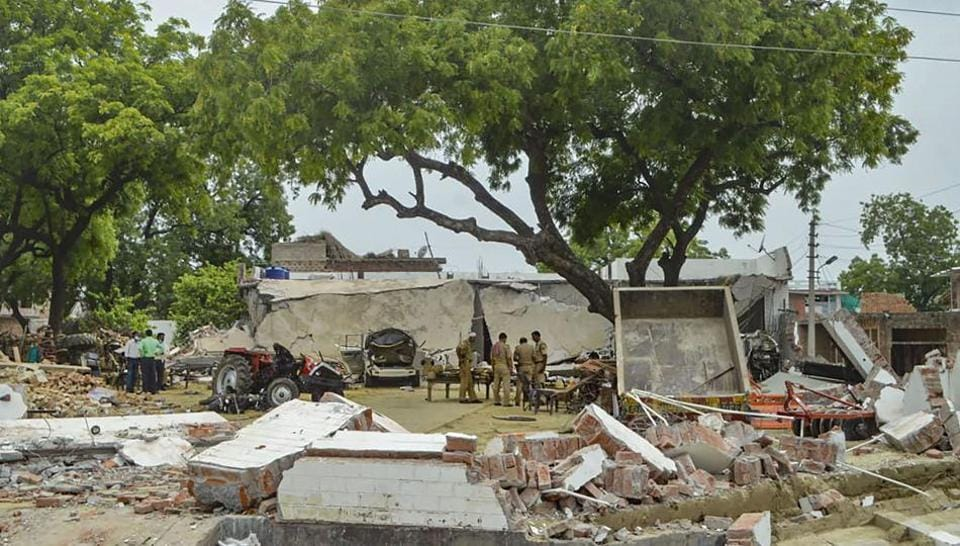 Debries lie on the ground after demolition of the residence of main accused in the Kanpur encounter case, Vikas Dubey, in Kanpur, on Sunday.