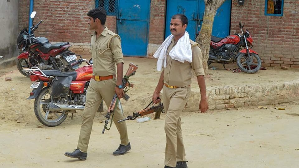 Police personnel during a search operation near the house of gangster Vikas Dubey in Kanpur on Sunday.