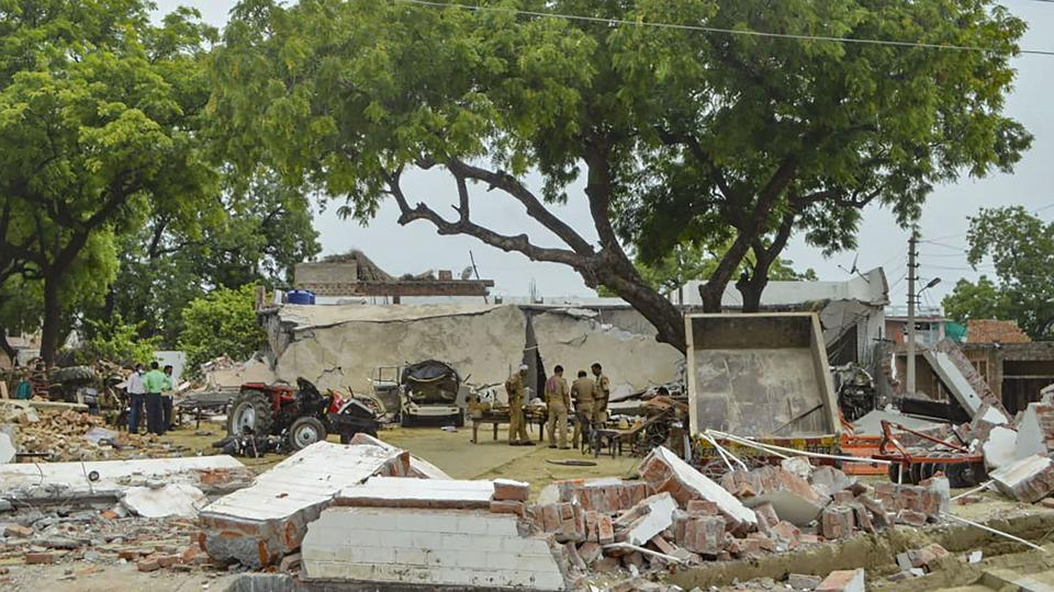 Debris lie on the ground after demolition of the house of gangster Vikas Dubey, in Kanpur on Sunday.