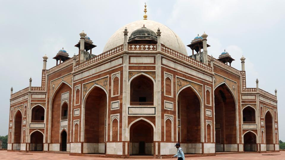 A security guard walks in front of Humayun's Tomb, after authorities reopened it for visitors following a three-month lockdown that was imposed to slow the spread of the coronavirus disease (Covid-19), in New Delhi.