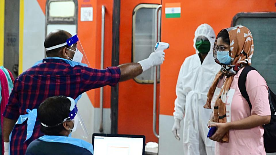 A passenger being tested with Thermal check after arriving at Thiruvananthapuram railway station through special train services during the ongoing lockdown amid coronavirus pandemic in Thiruvananthapuram in May 2020.