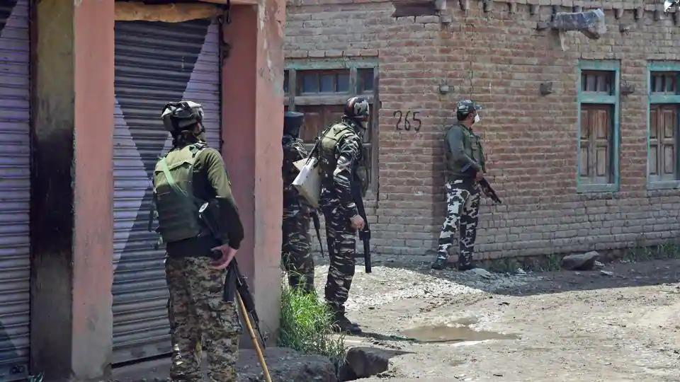 Army jawans take positions during an encounter with the militants in the Kangan area of Pulwama district of south Kashmir