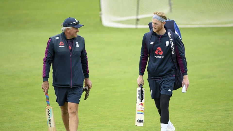 England cricket team captain Ben Stokes, right, speaks with coach Chris Silverwood during a nets session at the Ageas Bowl in Southampton, England, Monday July 6, 2020. England are scheduled to play West Indies in their first Test match July 8 - 12. (Stu Forster/Agency Pool via AP)